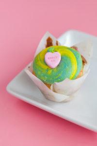 Conversation Heart $2.75 – A vanilla cupcake baked with conversation hearts topped with a marshmallow buttercream and topped with a conversation heart and edible glitter.