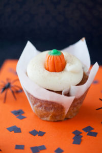 Pumpkin $2.50 - A super moist pumpkin cupcake topped with a cream cheese frosting, sprinkled with cinnamon and sugar.