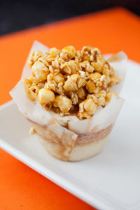 Caramel Popcorn $3.00 - a buttery vanilla cupcake topped with buttercream frosting, garnished with a scoop of our made from scrach caramel Popcorn. *Featured on Cupcake Wars*