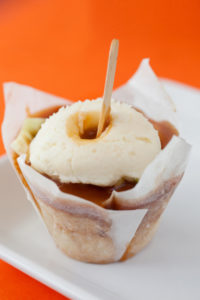 Caramel Apple $3.00 - A cinnamon sugar cupcake filled with fresh granny smith apples, topped with our made from scratch caramel, topped with cream cheese frosting.
