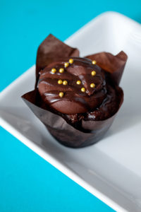 Chocolate Orange $3.00 It's a chocolate orange cupcake filled and topped with an orange ganache topped with chocolate frosting, drizzled with more ganache and topped with a orange peel.