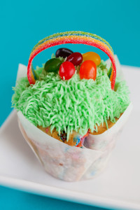Starburst Jelly Bean Surprise! $3 - Our very funfetti cupcake filled with Starburst Jelly Beans, topped with buttercream and buttercream grass, more jelly beans and a rainbow handle to resemble an easter basket.