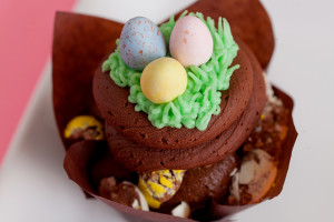 Easter Egg Hunt $3 - A chocolate cupcake baked with the famous mini cadbury eggs, topped with chocolate frosting and garnished with buttercream grass and of course more mini cadbury eggs.