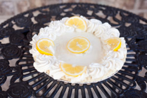 Sour Cream Lemon Pie $13.99 - Filled with our lemon curd topped with a layer of sourcream & whipped cream.