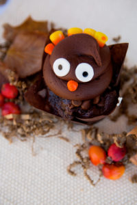 Chocolate Turkeys $3 -  A chocolate cupcake baked with both semi sweet and milk chocolate chips, topped with a chocolate frosting decorated as a Turkey.