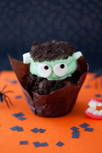 Mint Chocolate Oreo Frankenstein $3 - Chocolate cupcake baked with a whole oreo inside and filled with ganache, topped with a mint buttercream and garnished with crushed oreos.