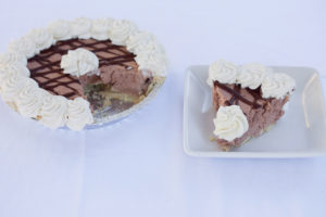 Chocolate Cream Pie $13.99 - Filled with our homemade chocolate mousse, drizzled with ganache and topped with whipped cream.