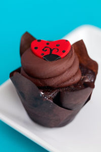 Love Bug $3– A chocolate cupcake baked with both semi sweet and milk chocolate chips, topped with a chocolate frosting and topped with a hand made fondant love bug.